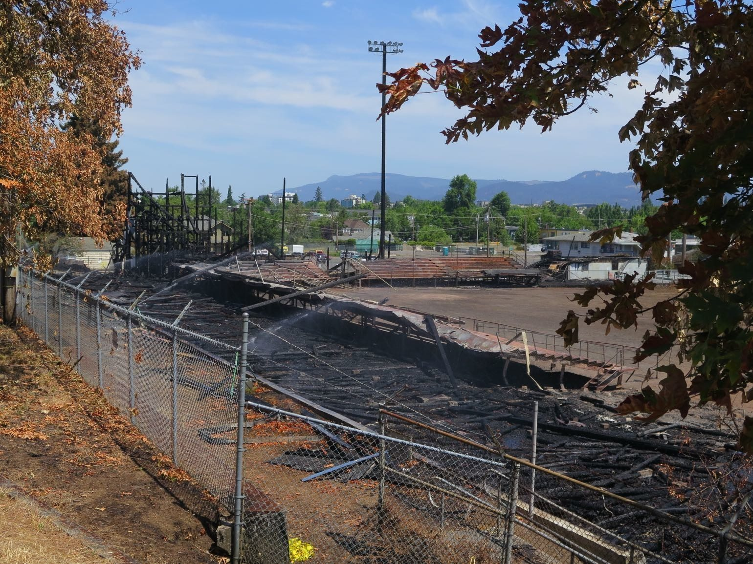 ashes and rubble from Civic Stadium fire in Eugene, Oregon